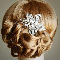 Vintage Inspired Wedding Hairstyles. To see more: http://www.modwedding.com/2014/05/19/vintage-inspired-wedding-hairstyles/ #hair #hairstyle