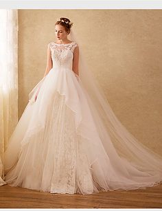 Looking for a classy high-neckline wedding dress? Then this might be the one for you! Tip: don't forget to wear a veil! Click for more details.