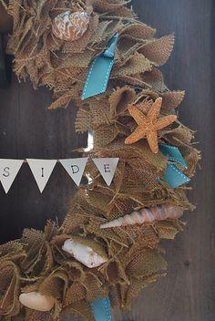 Burlap wreath with seashells.     http://gallamorewest.blogspot.com/2011/07/burlap-wreath-with-seashells.html