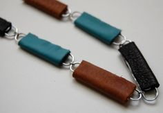 paper clip necklace, they use leather, you use clay.
