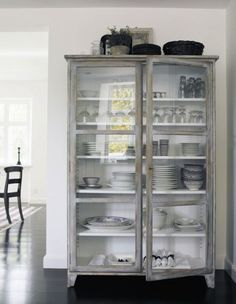 LOVE the open glass dish shelving! And especially the grey wash wood!
