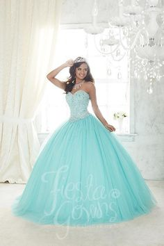 Beaded tulle makes this ball gown a fine selection, along with the bodice splashed with colored replica pearls and shining stones and a sweetheart neckline. Download the Fiesta Gowns by House of Wu si More