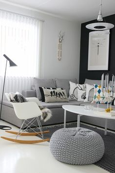 Nordic Influence. Love the bean bag and the little white chair with fur throw