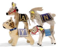 FOUR STEIFF U.S.A. MASCOTS:, a Bully for Yale, (1314,0), blue coat with a Y, collar and card tag --7in. (18cm.) long; a Donkey for the U.S. Army, (1314,0), black coat with a A --5½in. (14cm.) high; a Goat for the U.S. Naval Academy, (7315,90), blue coat with N --6in. (15.5cm.) long; and a velvet Donkey for the U.S. Democrat Party, (1412,0), blue coat with D.E.M., --5½in. (14cm.) long, all three with script buttons, yellow cloth tags and two with chest tags, 1956-60