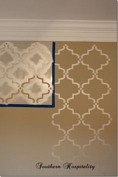 She provides step-by-step instructions and a resource for ordering stencils for the accent wall. SO doing this!