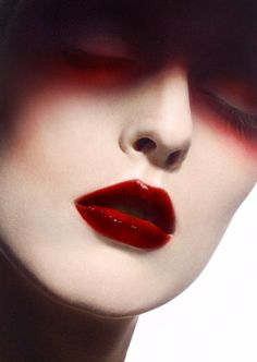 Deep Dark Red  Loving this 2010 advert from Ellis Faas. Deep dark red makeup look. Ooh the things you can do with red lipstick, so lovely!