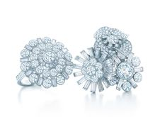fdb7a5f9440 Floral rings of baguette and round brilliant diamonds