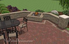 Fire pit area with built in fire pit and seating wall