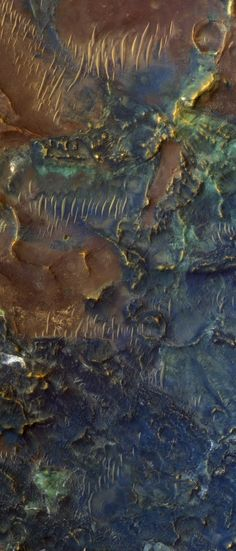 Toro Crater, Mars - The different colors reflect different mineral composition on the Martian surface. (Taken 12/1/11 by the High Resolution Imaging Science Experiment on NASA's Mars Reconnaissance Orbiter).