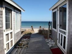 Overlooking Cape Cod Bay, this property is the ideal family vacation retreat. These updated cottages sit side by side, both with waterfront decks and a shared boardwalk and steps to the beach. They offer two separate ...