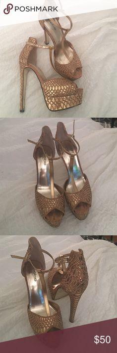 Bebe gold platform heels Gorgeous gold strappy platform heel. Bebe. Women's size 7 1/2. True to size. bebe Shoes Heels