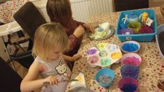 Making sponge cake with coloured shaving foam icing and water balls for decoration