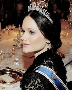 Princess Sofia of Sweden wearing a Varmland Tiara and diamond pearl drop earrings, she wore her brunette tresses in an elegant up-do, while displaying a flawless make-up look, attends a glittering state banquet at the Stockholm Palace