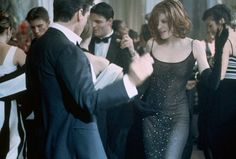 Rene Russo as Catherine Banning - Thomas Crown Affair - fabulous wardrobe and hair!!!