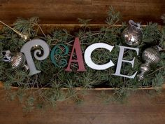 Peace wood letters in different fonts. Victorian, Curlz, CentSchBkCond, Copperplate, Times New Roman. Colors: Seal Grey, Hunter Green, Dark Red, White, Metallic Silver.