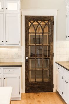 Home Remodeling Farmhouse Upgrade your kitchen with one of these cool pantry door ideas 60 opening. Whether you're loving farmhouse kitchens or want something modern, there's a door for you. House, Home, Vintage Home Decor, Vintage House, Kitchen Remodel, Home Remodeling, New Homes, Farmhouse Kitchen, Rafterhouse