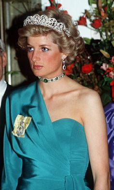 Diana, wearing a choker she had made from emeralds which had been given to her as a gift. And the Spencer family tiara.