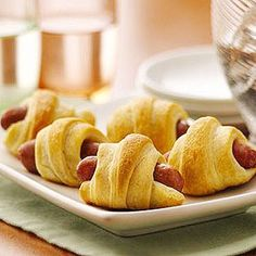 Mini sausages are all wrapped up in Pillsbury® flaky crescents in an all-time favorite appetizer.