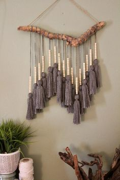 Easy driftwood Macrame hanging Driftwood foundation was found washed up on the coast of Florida near Fort Lauderdale beach. Yarn was individually measured, cut, and tied to create one single tassel. Small wooden beads were then Mur Diy, Yarn Wall Art, Wall Art Boho, Diy Wall Art, Diy And Crafts, Arts And Crafts, Yarn Crafts, Rope Crafts, Feather Crafts