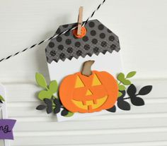 DIY Halloween tag by Lisa Henke for Reverse Confetti. Confetti Cuts: Halloween Bits, Pumpkin Patch, Top O' the Tag, and Leafy. RC cardstock: Lime Green and Tangerine. RC 6x6 paper pad: Fright Night.