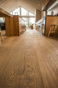 The house was carefully planned to reap the benefits of the gorgeous view. The design was kept simple. Engineered Wood Floors, Timber Flooring, Clean Lines, New Zealand, House Design, Interior Design, Grey, Simple, Kitchens