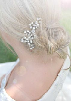 Small and delicate with a bit of sparkle.   Crystal headpiece, wedding hair jewelry, bride hair comb, Rhinestone hair accessory, bridal hair piece, jewel for hair, hair brooch, EMMA. 鈧?2.00, via Etsy.