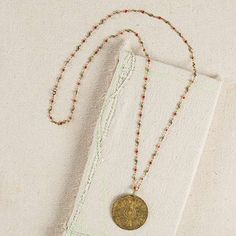 Red Metal Medallion Necklace - Add a little fun to a plain top with this double-sided brass medallion. Generous length chain has colorful red accents and is perfect for layering with any of our shorter necklaces or a custom Junk Market creation. ALL SALE ITEMS ARE FINAL SALE. Please refer to our Return Policy for more information.