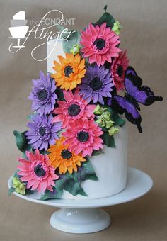 Gerber Daisy Butterfly Cake tiered coconut cake decorate with fondant gerber daisies and a butterfly Pretty Cakes, Beautiful Cakes, Amazing Cakes, Cake Decorating With Fondant, Cake Decorating Tips, Gerbera, Daisy Cakes, Cupcake Pictures, Fancy Cupcakes