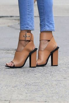 I believe this is Celine. Everything about this is perfect: the thick straps, the block heel, the warm nude tan color. There's a waitlist for this shoe, for good reason