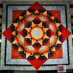 Woodcarvers Star featuring Tonga batiks. This one scores 10 on the wow scale…