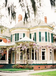 The chestnut Victorian house acorss from forsyth park in Savannah Ga with its beautiful wisteria