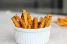 Butternut squash fries Ingredients 1 medium butternut squash, deseeded, peeled, and sliced into ½ inch fries 2 T. + 2 t. walnut oil (or another high smoke point oil) 1 t. curry powder ¼ t. cinnamon ⅛ t. ginger powder scant ½ t. sea salt Instructions Preheat the oven to 425 degrees. Mix the oil with the salt and spices. Toss the 'fries' in the spice mix. Lay the fries onto a parchment paper-lined cookie sheet (don't crowd them!). Bake for about 20 minutes until golden.