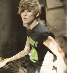 U-Kiss - Kevin See the thing with Mr. Kevin woo is that he goes from being this overly feminine to this masculine piece of art. Like he goes from being pretty to  handsome in like -.03 seconds , I don't know how to feel about him.