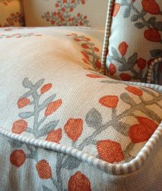 Wingback chair upholstery ideas-floral fabric with ticking stripe piping