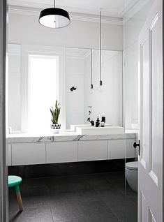 """Aussie Olympian Wins Gold on Home Renovation """"We wanted the window as the centrepiece in the bathroom, so we created a long marble bench with sinks either side,"""" Johanna says. The door adds a traditional touch to the modern space. Laundry In Bathroom, Bathroom Renos, Bathroom Interior, Small Bathroom, Bathroom Marble, Bathroom Ideas, Bathroom Goals, Bathroom With Window, Serene Bathroom"""