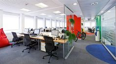 Open plan office coordinated with vivid colors. #openplanoffice Cubicles.com