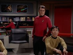 Uhura, possibly Chekov's arm, Scotty (looking as if he suspects Sulu of a dastardly deed), and Sulu (looking as if he may have pressed the wrong button.)