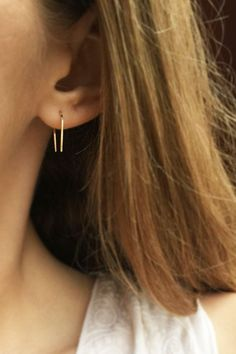 These minimalist gold horseshoe earrings are hand-hammered and polished to a high shine - to catch light beautifully. The flat hammering gives the