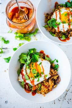 Kimchi Rice with Chopped Veggies and an Egg, topped with sriracha, scallions and cilantro. Healthy and flavorful! |www.feastingathome.com