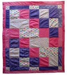 You'll love to make this snuggly baby quilt pattern for the little ones in your life. The Baby Steps Cuddle Quilt is constructed with a few simple squares and rectangles of plush fabric, but has an adorable stair step pattern.