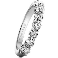 Platinum band with a half circle of round diamonds by Tiffany & Co....this would probably match my engagement ring the best. love this so much