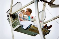 Love this whole wedding! A ferris wheel, tickets where you can win goldfish, cotton candy, balloons etc. love love love it!