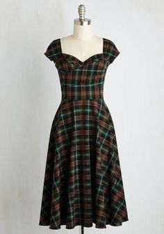 Pine All Mine Dress in Earthy Plaid. Bring the beauty of the coniferous forest to your wardrobe with this retro dress by Stop Staring! #green #modcloth