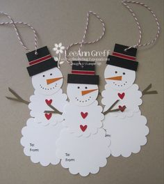 Cute snowman tags made from scalloped and regular circle punches. Would make a cute border, too.