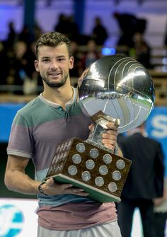 Bulgaria's Grigor Dimitrov poses with the trophy after winning the ATP Stockholm Open tennis tournament at the Royal Lawn Tennis Club (AP).