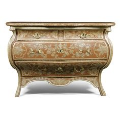 A fine and rare German gilt-bronze-mounted red lacquered and silvered wood commode, Dresden mid 18th century with a later moulded mottled liver and white marble top, above two short concave fronted drawers and one long bowed and another long shaped drawer with bombé sides above a shaped apron on splayed legs, the whole carved with trails of flowers, anthemions and acanthus leaves, within scrolled cartouches on a stippled ground