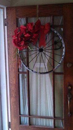 Bike wheel seasonal wreath by Ann Raffis  #gardenjunk #repurposed