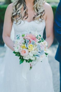 Pastel bridal bouquet idea - pastel roses, ranunculuses, and a large dahlia tied with a satin ribbon {Endless Wave Studios}