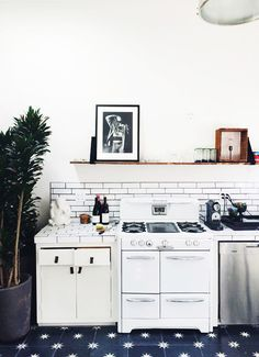 Patterned tiles on kitchen floors || desiretoinspire.net