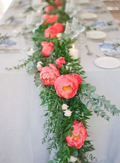 Wedding tables covered in garland and coral flowers: http://www.stylemepretty.com/2016/09/28/an-azur-coral-destination-wedding-on-the-french-riviera/ Photography: Greg Finck - http://www.gregfinck.com/